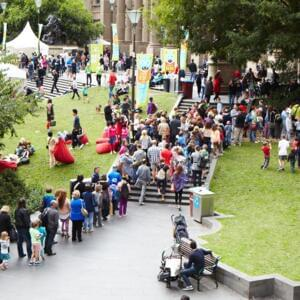 Aerial photograph of a large crowd on the lawn of the State Library