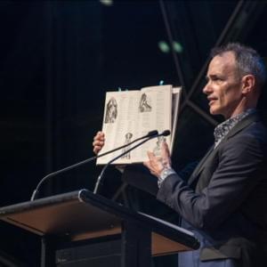 Photo of Andy Griffiths holding up a book