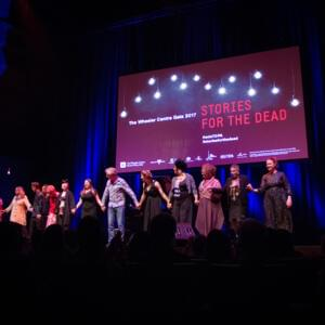 Photograph of 13 people on stage under a banner that reads 'The Wheeler Centre Gala 2017: Stories for the Dead'