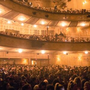 Photo of a full audience at the Athenaeum Theatre