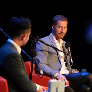 Photo of Benjamin Law and Andrew Sean Greer on red armchairs