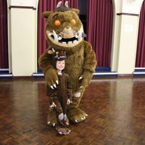 Photo of the Gruffalo with a young child in a Gruffalo suit